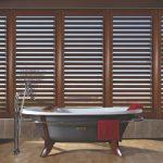 wood shutters bath tub window